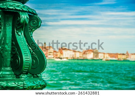 Green lantern on Giudecca island in Venice, Italy. In the background is a view on Venetian Lagoon with cityscape of Venice and beautiful blue sky. - stock photo