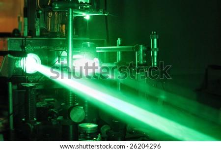green laser beam - stock photo