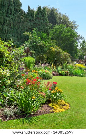 Green lawn in a colorful landscape formal garden. Beautiful Garden. - stock photo