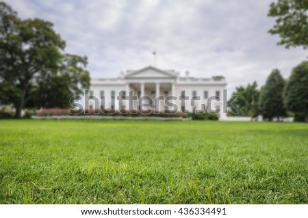 green lawn with the blurred White House in background, Washington D.C., USA