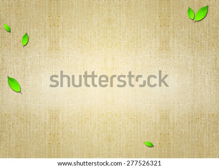 green leaf flora over brown grungy parchment canvas background. Backdrop, invitation card design idea template wallpaper. Decoration, ornament, layout, artistic design. - stock photo