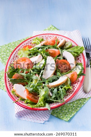 Green leaf salad with vegetables and chicken, selective focus - stock photo