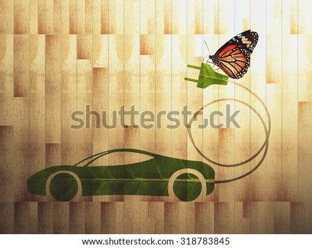 green leaf with a cut out car symbol on wood board background, Ecology concept, Cross process style - stock photo