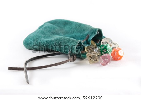 Green leather pouch with brown leather string, open with many sided dice falling out on a white isolated background. - stock photo