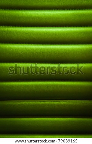 green leather seats are welded to horizontal suture - stock photo