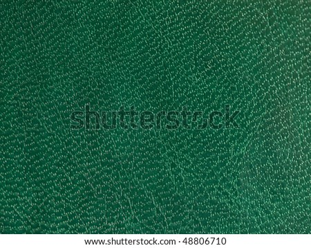 Green leather surface - stock photo