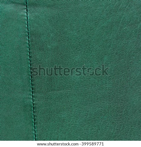 green  leather texture decorated with seam