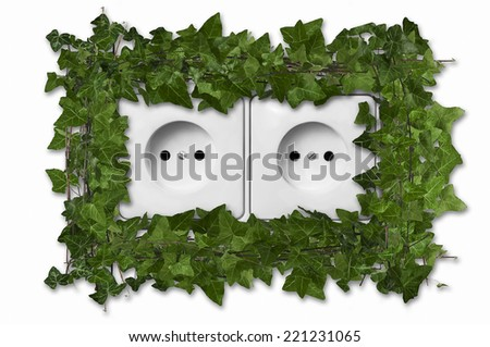 Green leaves growing from dual european wall outlet suggesting green energy - stock photo