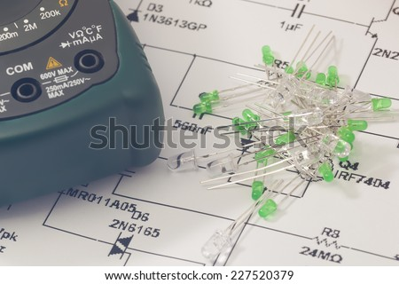 Green LEDs and electronic scheme - stock photo