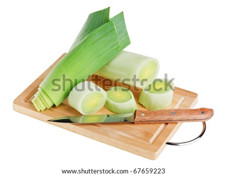 Green leek with knife on wooden chopping board over white background - stock photo
