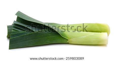 green leeks on white background