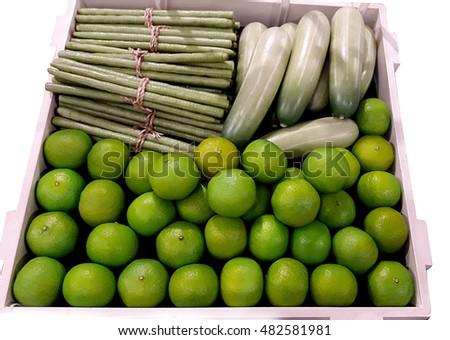green Lemon , cucumber , beans , forged in plastic crates
