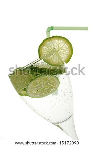Green lemon in glass with water. On the white background - stock photo