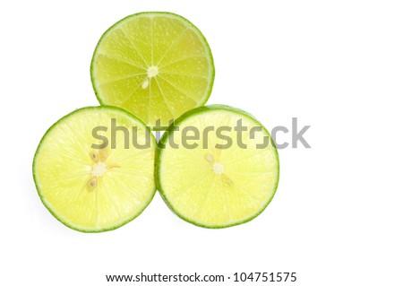 Green lemon slice backlit on white background - stock photo