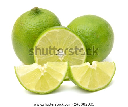 green lemons and slices on white background - stock photo