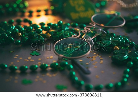 Green: Leprechaun Glasses On Metal And Confetti Background - stock photo