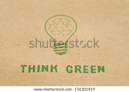 Green light and recycle symbol on cardboard - stock photo