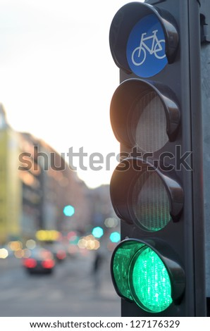green light for bicycle traffic at the crossroads - stock photo