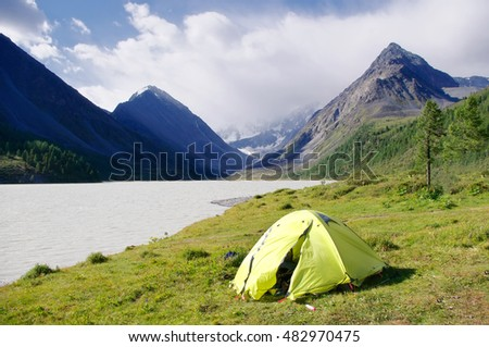 Green mountain range stock images royalty free images vectors green light green tent on the grassy shore of a mountain lake amid snow capped sciox Gallery