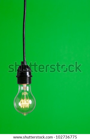 Green Light isolated hanging in the studio - stock photo