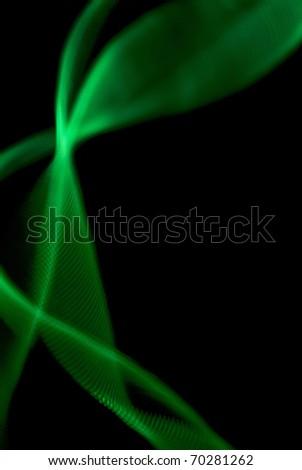 Green light painted streak on a black background - stock photo