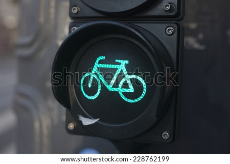 Green light sign for bicycle lane on a traffic light  - stock photo
