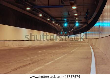 Green Lights Ahead inside an empty urban tunnel. - stock photo