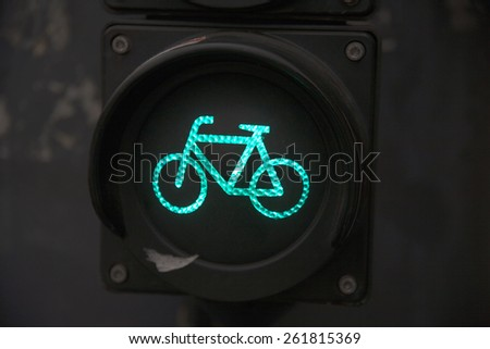 Green lights for bicicle lane. Traffic light for bikers - stock photo