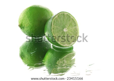 Green lime and lime slice with reflection