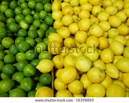 green lime and yellow lemons for sale at a local farmers market