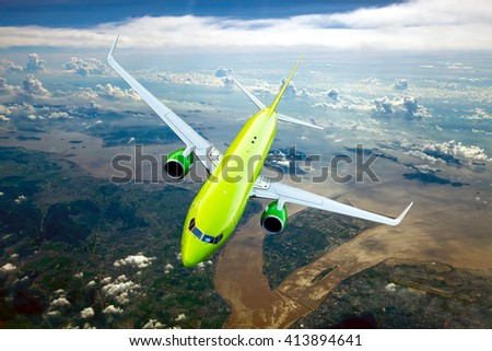 Green / lime passenger plane. Aircraft is flying in the cloudy sky over fields and river. - stock photo