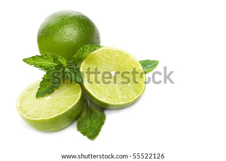 Green limes with mint isolated on white - stock photo