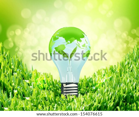 green litgh bulb  on green a grass. concept love the earth.