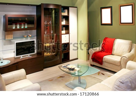 Green living room with big brown closet - stock photo
