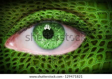Green lizard pattern on face - stock photo