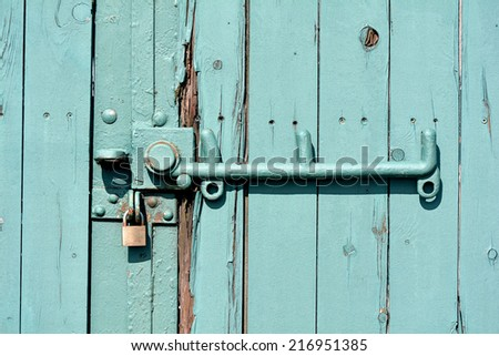 green locked door on a building in the port of Magdeburg - stock photo