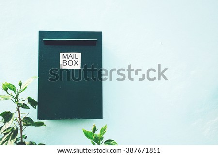 Green mailbox on the wall - stock photo