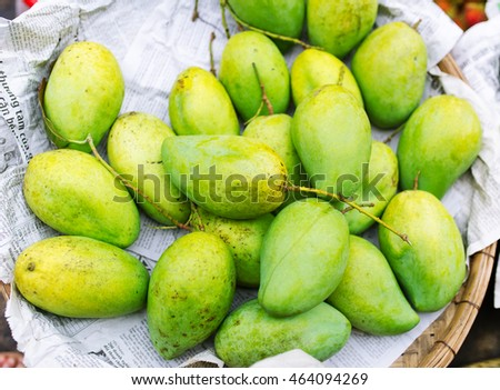 green mango in basket (focus mango at center)