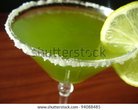 Green Margarita with lime - stock photo