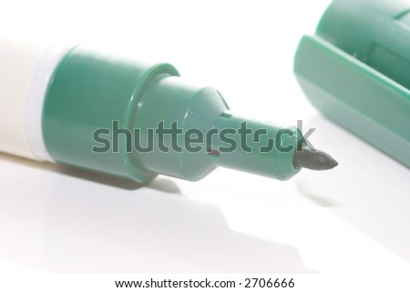 green marker on white background