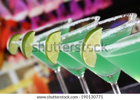 Green Martini Cocktails in glasses in a bar or a party - stock photo