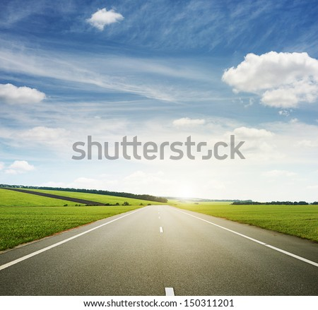 green meadow and speedway - stock photo