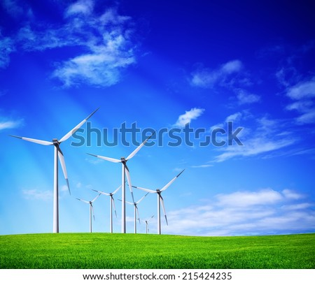 Green meadow with wind turbines - stock photo