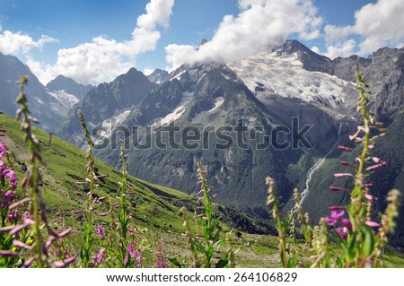 Green meadows towards russian borders, lost in Caucasus - stock photo