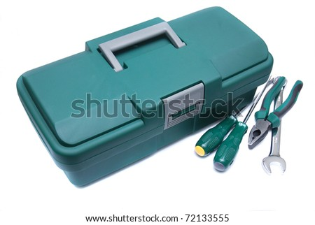 green mechanic's basic tool box with set of spanner,pliers and screwdrivers - stock photo