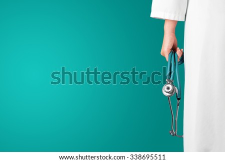Green medical background with female doctor and stethoscope - stock photo