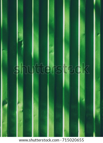 green metal pattern container wall