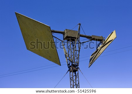green militray antenna on blue background - stock photo