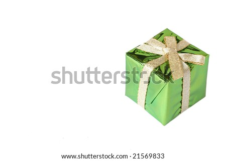 Green mini gift box with gold ribbon isolated on white background with copy space - stock photo