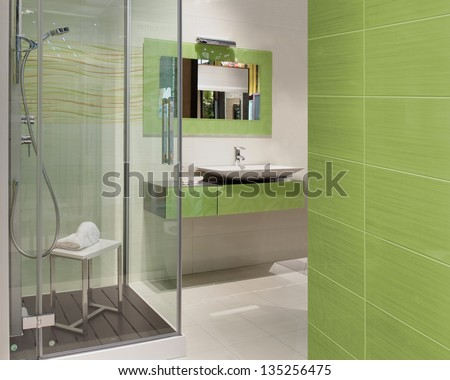 green modern bathroom with a big shower a washbasin - stock photo